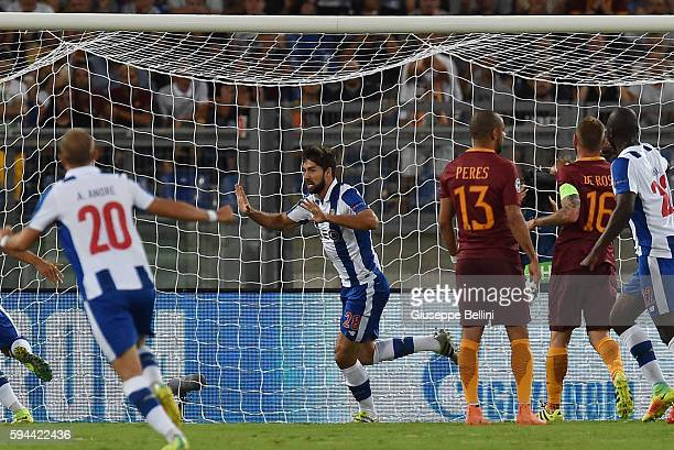 Felipe of FC Porto celebrates after scoring the opening goal during the UEFA Champions League qualifying playoffs match between FC Porto and AS Roma...
