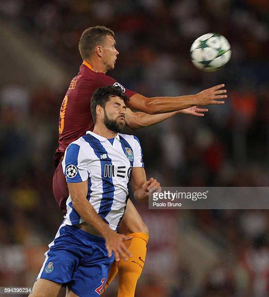 Felipe of FC Porto competes for the ball with Edin Dzeko of AS Roma during the UEFA Champions League qualifying playoff round second leg match...