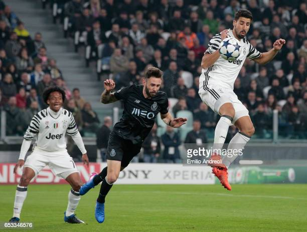Felipe of FC Porto jumps for the ball with Sami Khedira of Juventus FC during the UEFA Champions League Round of 16 second leg match between Juventus...