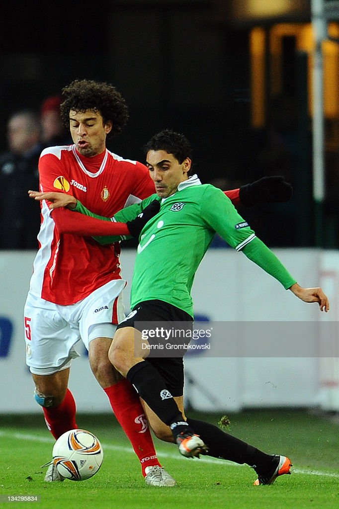 Felipe of Liege and Karim Haggui of Hannover battle for the ball during the UEFA Europa League group B match between R Standard de Liege and Hannover...