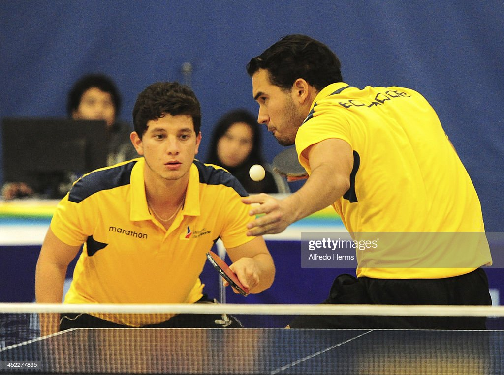 Felipe Olivares and Alejandro Rodriguez of Chile and Alberto Miño and Dino Suarez compete in men's double table tenis final match as part of the XVII Bolivarian Games Trujillo 2013 at Club Regatas on November 27, 2013 in Lima, Peru.