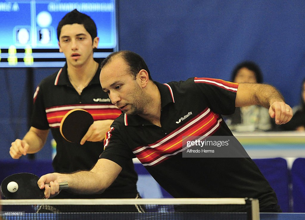 Felipe Olivares and Alejandro Rodriguez of Chile compete during the men's double table tenis final match as part of the XVII Bolivarian Games Trujillo 2013 at Club Regatas on November 27, 2013 in Lima, Peru.