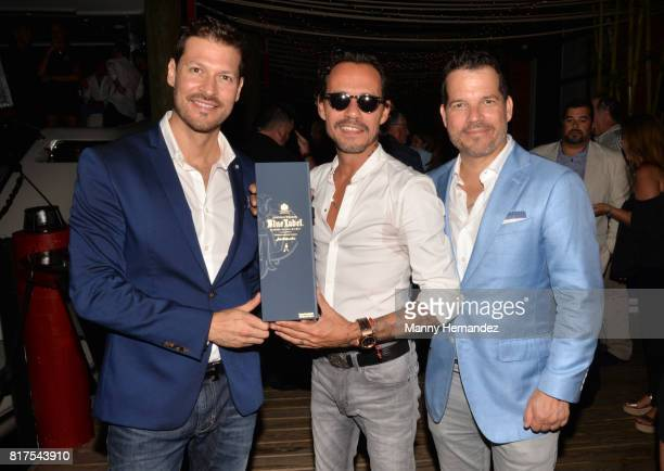 Felipe Pimiento Marc Anthony and Michel Vega at the Magnus Sports event at Sea Spice in the Miami River on July 11 2017 in Miami Florida