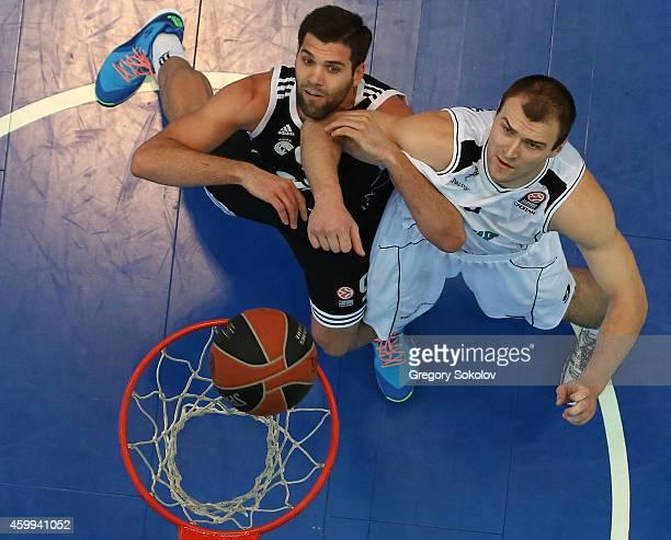 Felipe Reyes #9 of Real Madrid competes with Artsiom Parakhouski #9 of Nizhny Novgorod during the 20142015 Turkish Airlines Euroleague Basketball...