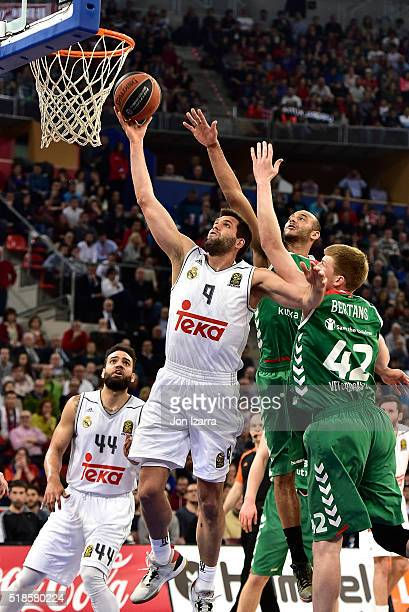Felipe Reyes #9 of Real Madrid competes with Davis Bertans #42 of Laboral Kutxa Vitoria Gasteiz and Adam Hanga #8 of Laboral Kutxa Vitoria Gasteiz...