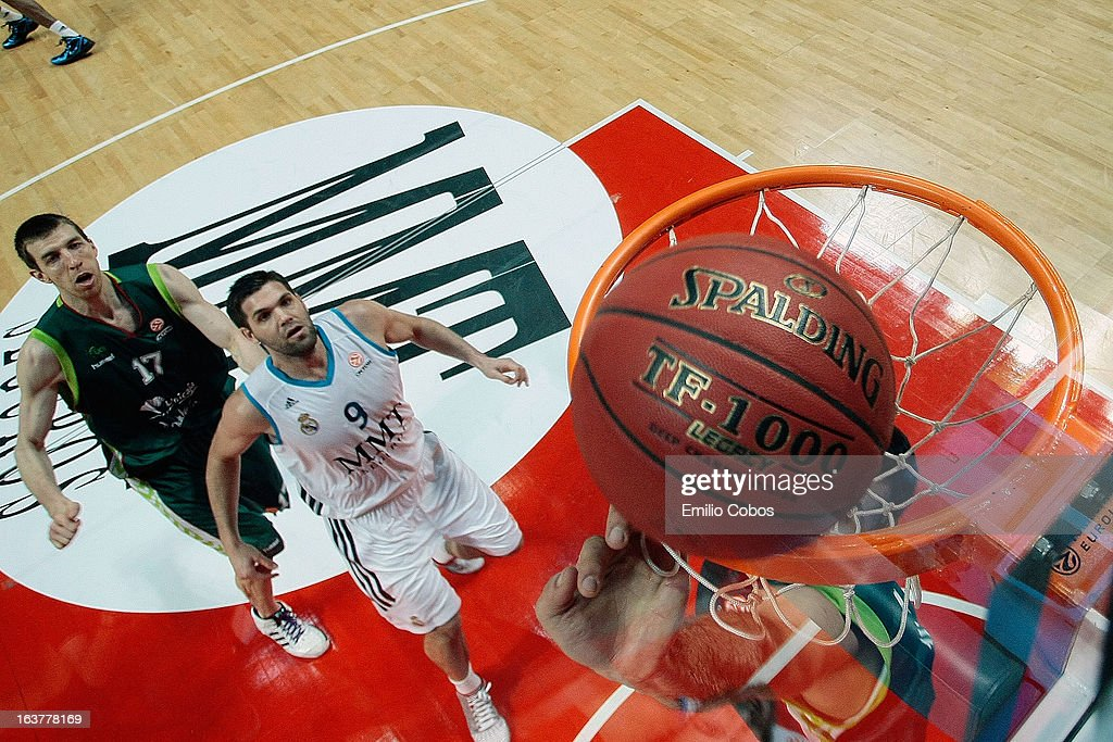 Felipe Reyes, #9 of Real Madrid competes with Fran Vazquez, #17 of Unicaja Malaga during the 2012-2013 Turkish Airlines Euroleague Top 16 Date 11 between Real Madrid v Unicaja Malaga at Palacio Deportes Comunidad de Madrid on March 15, 2013 in Madrid, Spain.