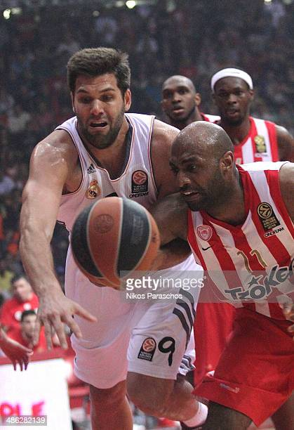 Felipe Reyes #9 of Real Madrid competes with Mardy Collins #11 of Olympiacos Piraeus during the Turkish Airlines Euroleague Basketball Play Off Game...