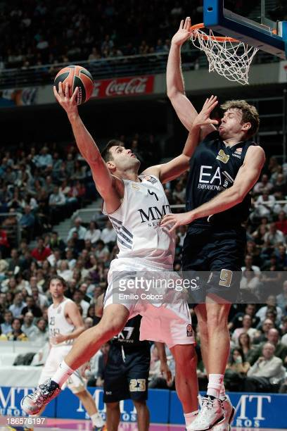Felipe Reyes #9 of Real Madrid competes with Nicolo Melli #9 of EA7 Emporio Armani Milan during the 20132014 Turkish Airlines Euroleague Regular...