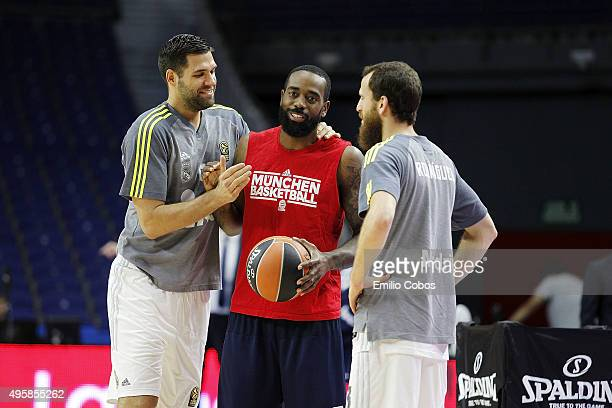 Felipe Reyes #9 of Real Madrid KC Rivers #5 of FC Bayern Munich and Sergio Rodriguez #13 of Real Madrid talks before the game during the Turkish...