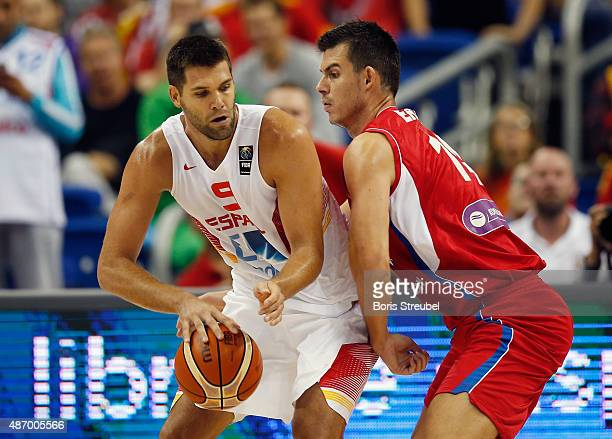 Felipe Reyes of Spain drives to the basket against Zoran Erceg of Serbia during the FIBA EuroBasket 2015 Group B basketball match between Spain and...