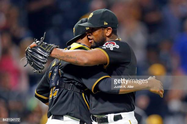 Felipe Rivero and Elias Diaz of the Pittsburgh Pirates celebrates after defeating the Chicago Cubs 43 at PNC Park on September 5 2017 in Pittsburgh...