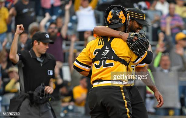 Felipe Rivero of the Pittsburgh Pirates hugs Elias Diaz after the final out in the Pittsburgh Pirates 31 win over the Cincinnati Reds at PNC Park on...
