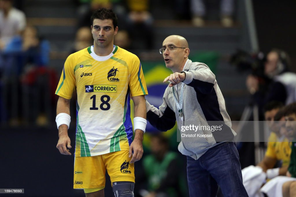 Felipe Robieiro and head coach Jordi Ribera of Brazil talk during the premilary group A match between Brasil and Argentina and Montenegro at Palacio de Deportes de Granollers on January 13, 2013 in Granollers, Spain.