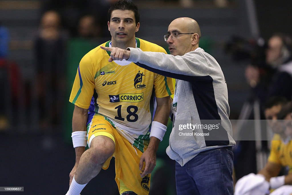 Felipe Robieiro and head coach Jordi Ribera of Brazil talks during the premilary group A match between Brasil and Argentina and Montenegro at Palacio de Deportes de Granollers on January 13, 2013 in Granollers, Spain.