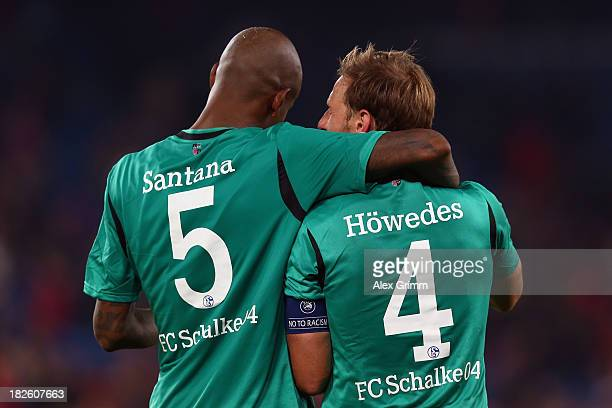 Felipe Santana and Benedikt Hoewedes of Schalke celebrate after the UEFA Champions League Group E match between FC Basel 1893 and FC Schalke 04 at St...