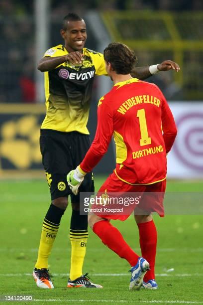Felipe Santana and Roman Weidenfeller of Dortmund celebrate the 20 victory after the Bundesliga match between Borussia Dortmund and FC Schalke 04 at...