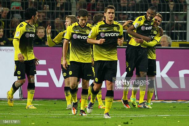Felipe Santana celebrates the second goal with Mario Goetzeof Dortmund during the Bundesliga match between Borussia Dortmund and FC Schalke 04 at...