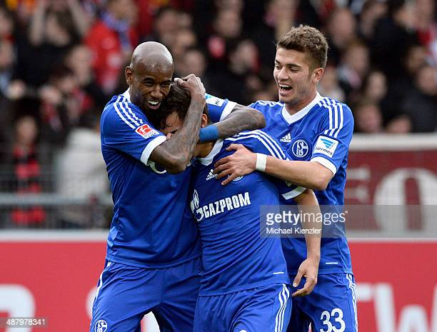 Felipe Santana Kaan Ayhan and Roman Neustadter of Schalke 04 celebrate opening goal of Ayhan during the Bundesliga match between SC Freiburg and FC...