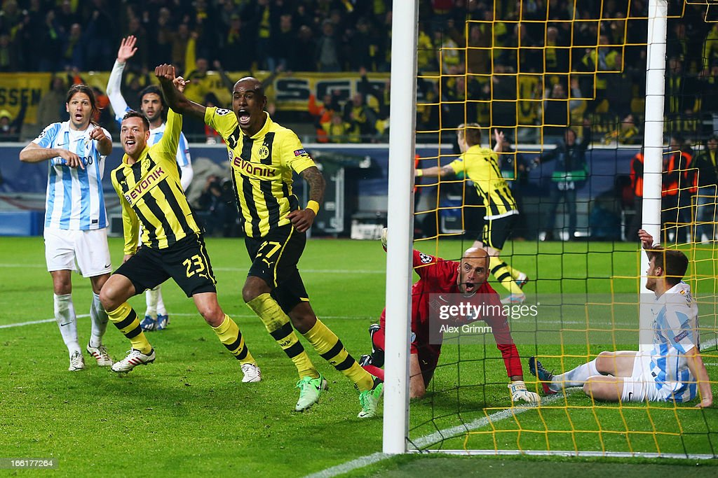 Felipe Santana (C) of Borussia Dortmund celebrates scoring their third and winning goal with team mate Julian Schieber as goalkeeper Willy Caballero and Martin Demichelis (L) of Malaga react during the UEFA Champions League Quarter Final second leg match between Borussia Dortmund and Malaga at Signal Iduna Park on April 9, 2013 in Dortmund, Germany.