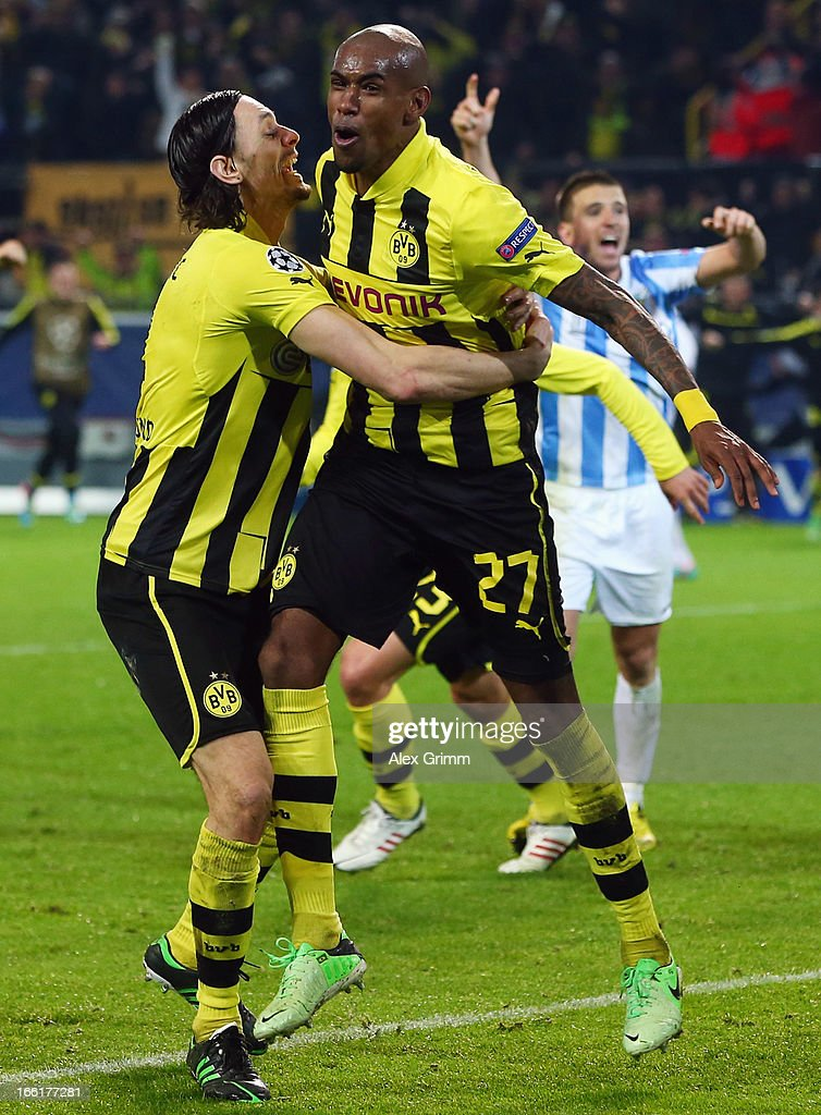 <a gi-track='captionPersonalityLinkClicked' href=/galleries/search?phrase=Felipe+Santana&family=editorial&specificpeople=5422021 ng-click='$event.stopPropagation()'>Felipe Santana</a> (R) of Borussia Dortmund celebrates scoring their third and winning goal with team mate <a gi-track='captionPersonalityLinkClicked' href=/galleries/search?phrase=Neven+Subotic&family=editorial&specificpeople=2234315 ng-click='$event.stopPropagation()'>Neven Subotic</a> during the UEFA Champions League Quarter Final second leg match between Borussia Dortmund and Malaga at Signal Iduna Park on April 9, 2013 in Dortmund, Germany.