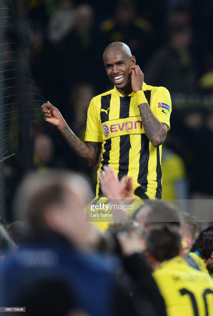 <a gi-track='captionPersonalityLinkClicked' href=/galleries/search?phrase=Felipe+Santana&family=editorial&specificpeople=5422021 ng-click='$event.stopPropagation()'>Felipe Santana</a> of Borussia Dortmund celebrates victory after scoring the third and winning goal that puts his team into the semi-finals during the UEFA Champions League quarter-final second leg match between Borussia Dortmund and Malaga at Signal Iduna Park on April 9, 2013 in Dortmund, Germany.