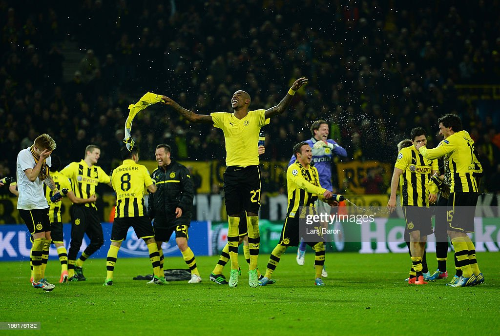 <a gi-track='captionPersonalityLinkClicked' href=/galleries/search?phrase=Felipe+Santana&family=editorial&specificpeople=5422021 ng-click='$event.stopPropagation()'>Felipe Santana</a> of Borussia Dortmund celebrates victory and a place in the semi-finals with his tea mamtes during the UEFA Champions League quarter-final second leg match between Borussia Dortmund and Malaga at Signal Iduna Park on April 9, 2013 in Dortmund, Germany.