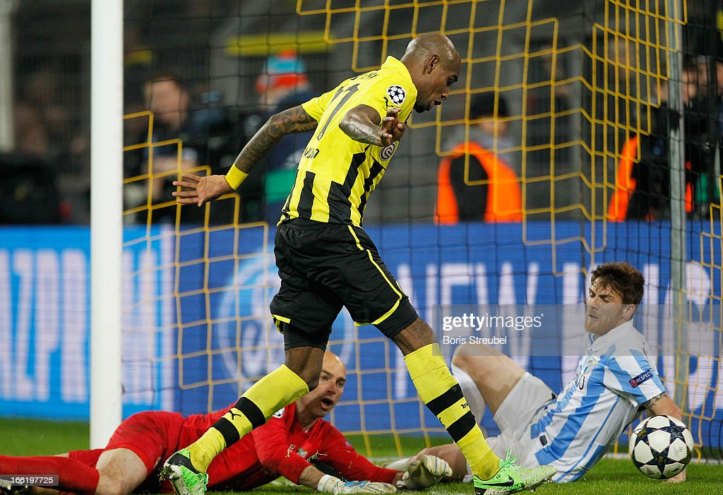 <a gi-track='captionPersonalityLinkClicked' href=/galleries/search?phrase=Felipe+Santana&family=editorial&specificpeople=5422021 ng-click='$event.stopPropagation()'>Felipe Santana</a> (C) of Borussia Dortmund scores their third and winning goal during the UEFA Champions League quarter-final second leg match between Borussia Dortmund and Malaga at Signal Iduna Park on April 9, 2013 in Dortmund, Germany.