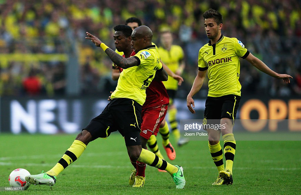 Felipe Santana ( L) of Dortmund and David Alaba of Muenchen compete for the ball during the Bundesliga match between Borussia Dortmund and FC Bayern Muenchen at Signal Iduna Park on May 4, 2013 in Dortmund, Germany.