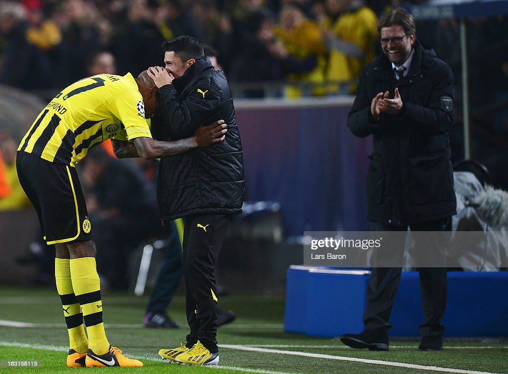 <a gi-track='captionPersonalityLinkClicked' href=/galleries/search?phrase=Felipe+Santana&family=editorial&specificpeople=5422021 ng-click='$event.stopPropagation()'>Felipe Santana</a> of Dortmund celebrates with team mate Leonardo Bittencourt after scoring his teams first goal during the UEFA Champions League round of 16 second leg match between Borussia Dortmund and Shakhtar Donetsk at Signal Iduna Park on March 5, 2013 in Dortmund, Germany.
