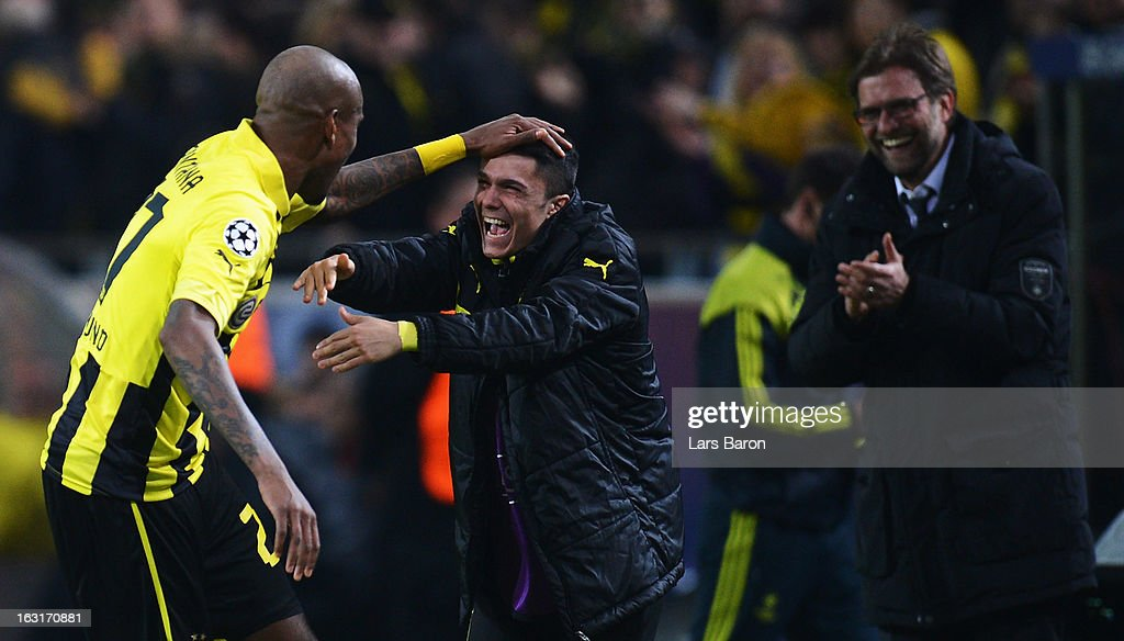 Felipe Santana of Dortmund celebrates with team mate Leonardo Bittencourt after scoring his teams first goal during the UEFA Champions League round of 16 second leg match between Borussia Dortmund and Shakhtar Donetsk at Signal Iduna Park on March 5, 2013 in Dortmund, Germany.