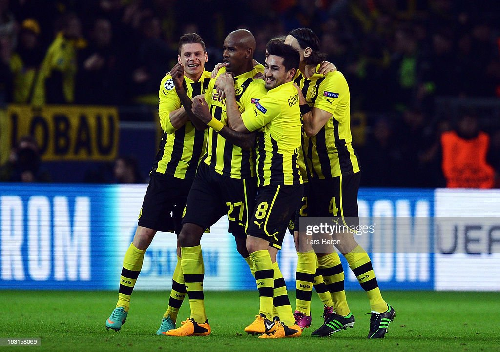 <a gi-track='captionPersonalityLinkClicked' href=/galleries/search?phrase=Felipe+Santana&family=editorial&specificpeople=5422021 ng-click='$event.stopPropagation()'>Felipe Santana</a> of Dortmund celebrates with team mates after scoring his teams first goal during the UEFA Champions League round of 16 second leg match between Borussia Dortmund and Shakhtar Donetsk at Signal Iduna Park on March 5, 2013 in Dortmund, Germany.