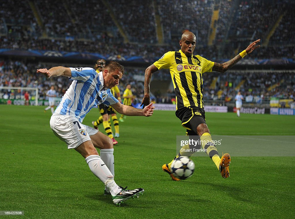 <a gi-track='captionPersonalityLinkClicked' href=/galleries/search?phrase=Felipe+Santana&family=editorial&specificpeople=5422021 ng-click='$event.stopPropagation()'>Felipe Santana</a> of Dortmund challenges for the ball with Manuel Iturra of Malaga during the UEFA Champion League quarter final first leg match between Malaga CF and Borussia Dortmund at La Rosaleda Stadium on April 3, 2013 in Malaga, Spain.