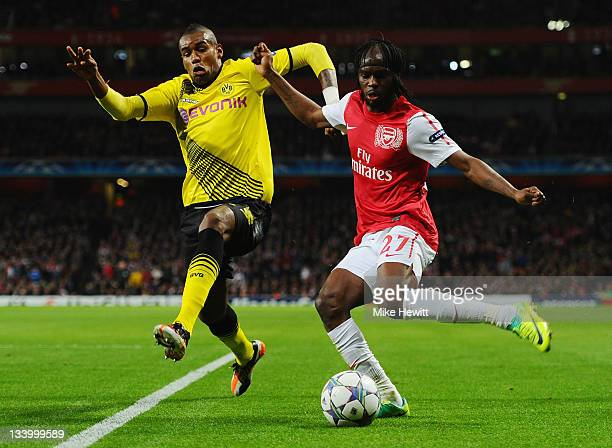 Felipe Santana of Dortmund fights for the ball with Gervinho of Arsenal during the UEFA Champions League Group F match between Arsenal FC and...