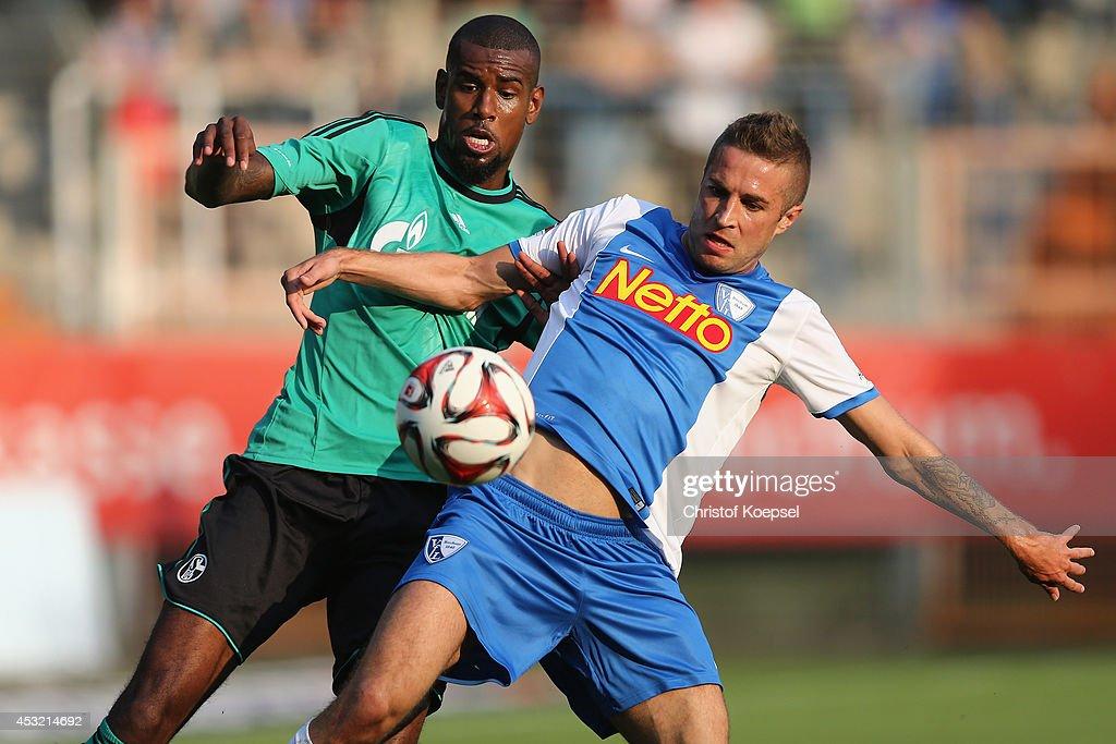 Felipe Santana of Schalke challenges of Anthony Losilla of Bochum during the pre-season friendly match between VfL Bochum and FC Schalke 04 at Rewirpower Stadium on August 5, 2014 in Bochum, Germany.