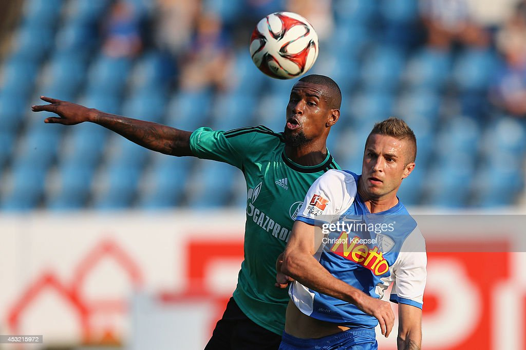 <a gi-track='captionPersonalityLinkClicked' href=/galleries/search?phrase=Felipe+Santana&family=editorial&specificpeople=5422021 ng-click='$event.stopPropagation()'>Felipe Santana</a> of Schalke challenges of Anthony Losilla of Bochum during the pre-season friendly match between VfL Bochum and FC Schalke 04 at Rewirpower Stadium on August 5, 2014 in Bochum, Germany.