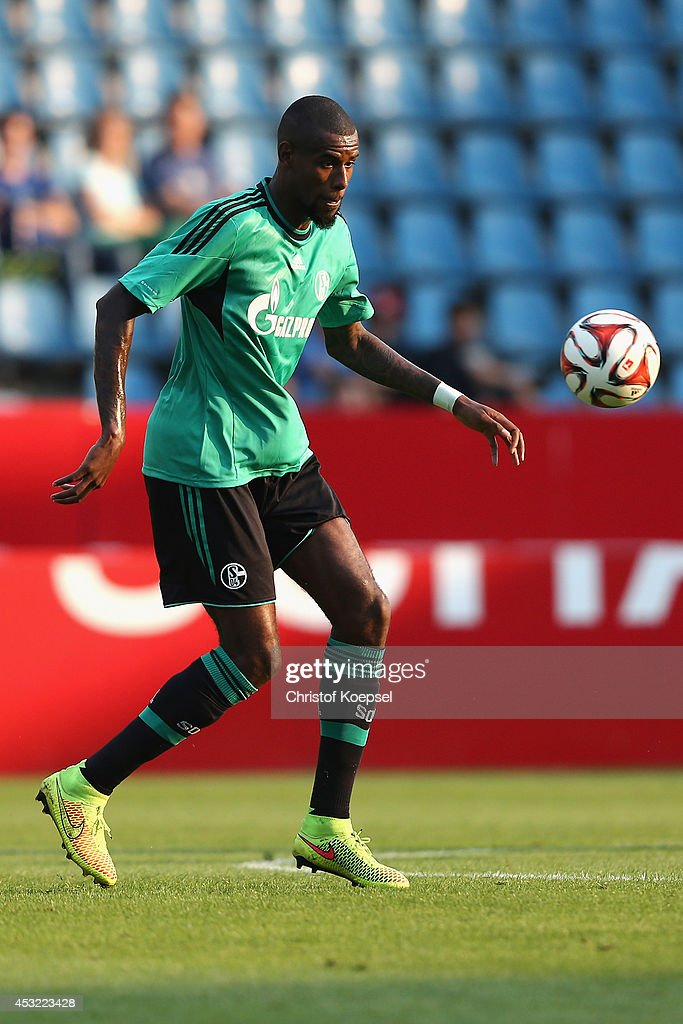Felipe Santana of Schalke runs with the ball during the pre-season friendly match between VfL Bochum and FC Schalke 04 at Rewirpower Stadium on August 5, 2014 in Bochum, Germany.