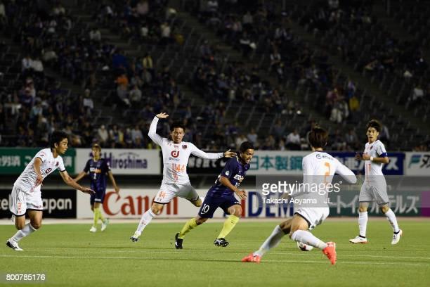 Felipe Silva of Sanfrecce Hiroshima and Yusuke Segawa of Omiya Ardija compete for the ball during the JLeague J1 match between Sanfrecce Hiroshima...