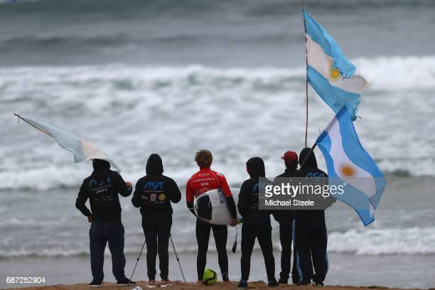 Felipe Suarez of Argentina looks out to the course alongside team members ahead of the Men's Main Round Heats on day four of the ISA World Surfing...
