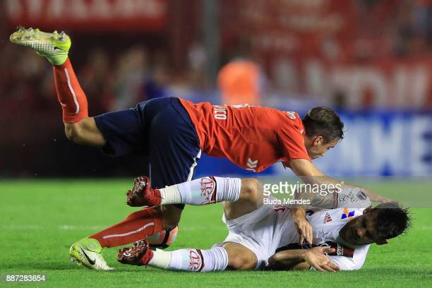 Felipe Vizeu of Flamengo struggles for the ball with Nicolas Tagliafico of Independiente during the first leg of the Copa Sudamericana 2017 final...