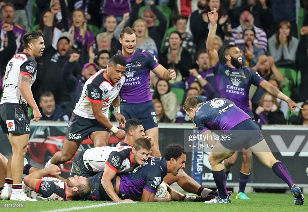 Felise Kaufusi of the Melbourne Storm scores a try as Josh Addo-Carr celebrates during the round eight NRL match between the Melbourne Storm and the New Zealand Warriors at AAMI Park on April 25, 2017 in Melbourne, Australia.