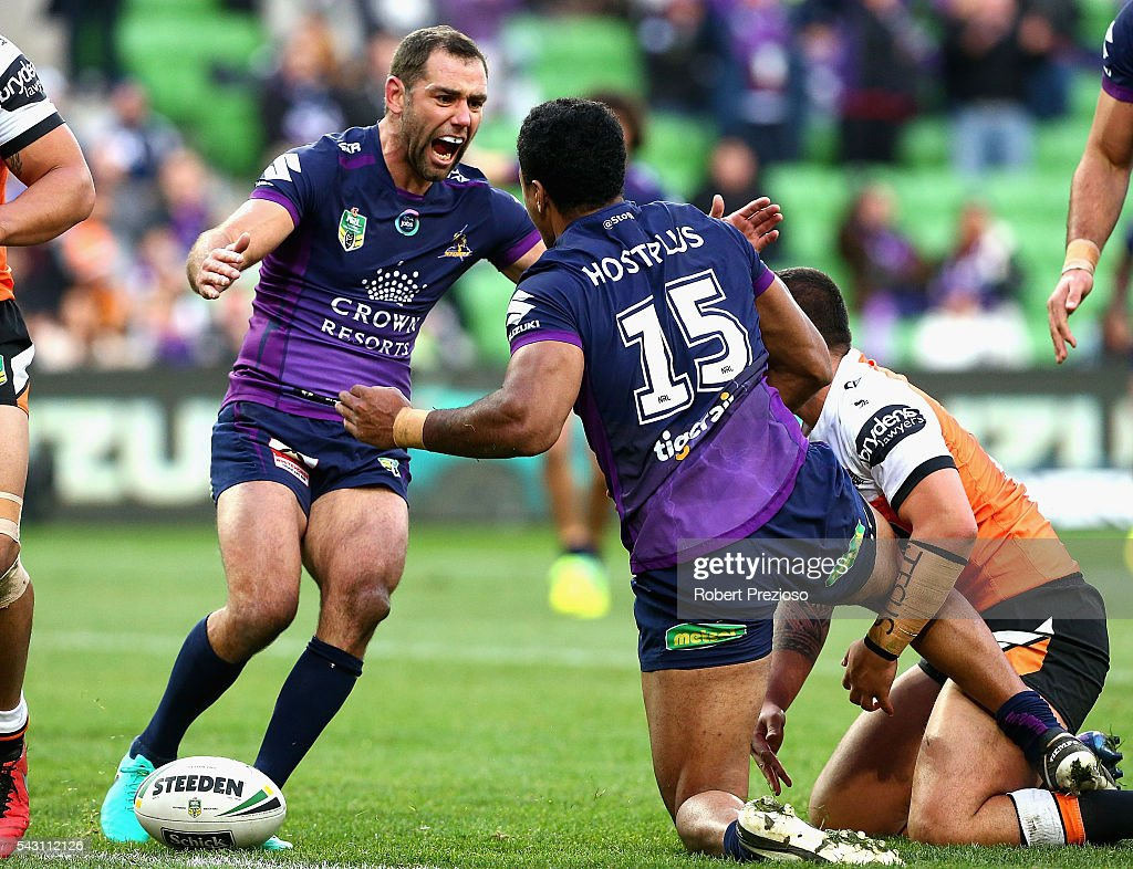 Felise Kaufusi of the Storm celebrates with team-mate Cameron Smith of the Storm after crossing the line to score a try during the round 16 NRL match between the Melbourne Storm and Wests Tigers at AAMI Park on June 26, 2016 in Melbourne, Australia.