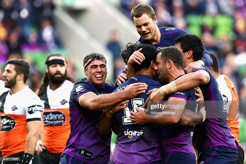 Felise Kaufusi of the Storm celebrates with team-mates after crossing the line to score a try during the round 16 NRL match between the Melbourne Storm and Wests Tigers at AAMI Park on June 26, 2016 in Melbourne, Australia.