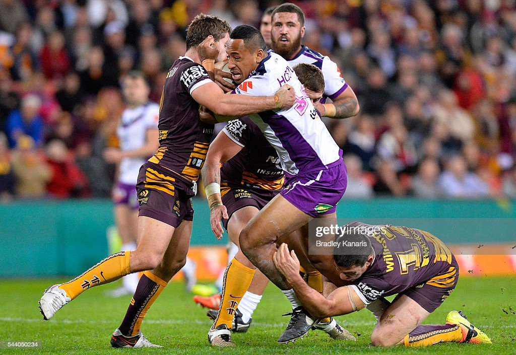 Felise Kaufusi of the Storm takes on the defence during the round 17 NRL match between the Brisbane Broncos and the Melbourne Storm at Suncorp Stadium on July 1, 2016 in Brisbane, Australia.