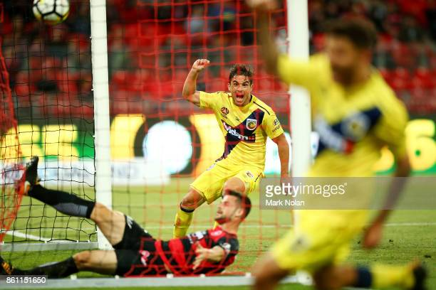 Felix Asdruval Padron Hernandez of the Mariners celebrates a goal by team mate Daniel De Silva during the round two ALeague match between the Western...