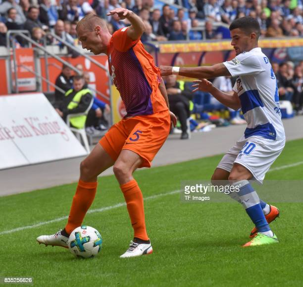 Felix Bastians of Bochum and Cauly Oliveira Souza of Duisburg battle for the ball during the Second Bundesliga match between MSV Duisburg and VfL...