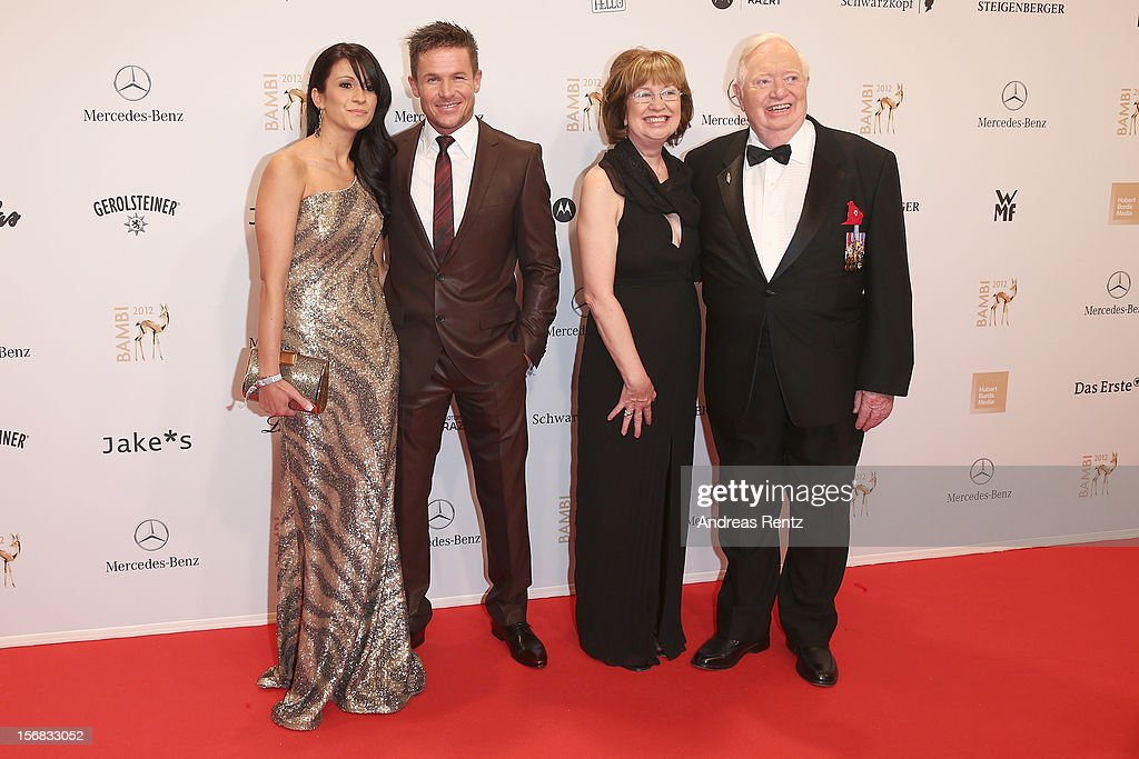 <a gi-track='captionPersonalityLinkClicked' href=/galleries/search?phrase=Felix+Baumgartner&family=editorial&specificpeople=787796 ng-click='$event.stopPropagation()'>Felix Baumgartner</a> and partner Nicole Oettli and Joe Kittinger with wife Sherry attend 'BAMBI Awards 2012' at the Stadthalle Duesseldorf on November 22, 2012 in Duesseldorf, Germany.