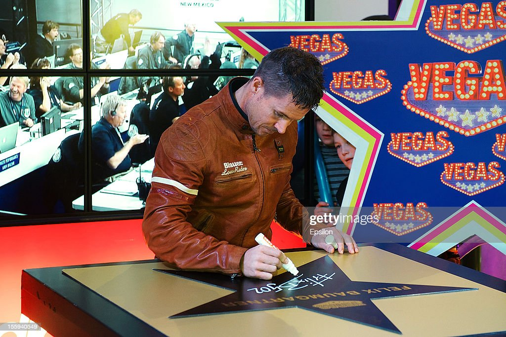 <a gi-track='captionPersonalityLinkClicked' href=/galleries/search?phrase=Felix+Baumgartner&family=editorial&specificpeople=787796 ng-click='$event.stopPropagation()'>Felix Baumgartner</a> attends his star ceremony at the 'Vegas' store Walk of Fame on November 09, 2012 in Moscow, Russia. Austrian <a gi-track='captionPersonalityLinkClicked' href=/galleries/search?phrase=Felix+Baumgartner&family=editorial&specificpeople=787796 ng-click='$event.stopPropagation()'>Felix Baumgartner</a> broke the world record for the highest free fall in history after making a 23-mile ascent in capsule attached to a massive balloon.