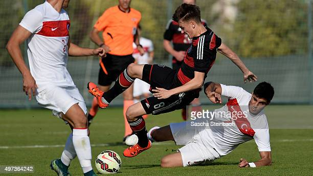 Felix Beiersdorf of Germany is brought down by Mehmet Yesil of Turkey during the U18 four nations friendly tournament match between Turkey and...