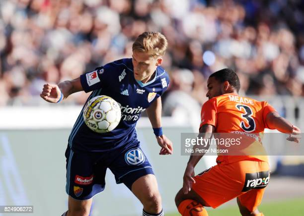 Felix Beijmo of Djurgardens IF and Jernade Mead of Athletic FC Eskilstuna competes for the ball during the Allsvenskan match between Athletic FC...