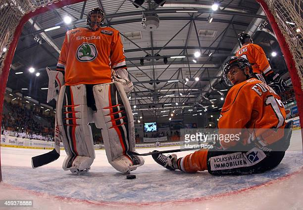 Felix Brueckmann goaltender of Wolfsburg and team mate Sebastian Furchner look dejected during the DEL match between Grizzly Adams Wolfsburg and...